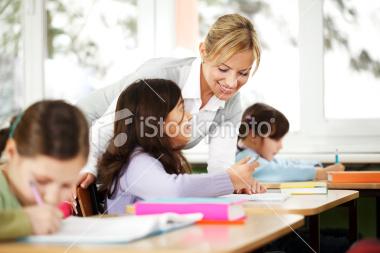 stock-photo-15509789-teacher-explains-in-the-classroom-children-are-listening
