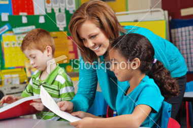 stock-photo-16175635-elementary-school-girl-looking-at-test-paper-with-teacher
